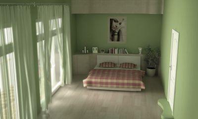Przykład sypialni w innym odcieniu koloru zilonego, kolor na ścianach uzupełniony progiem i firankami, narzuta na łóżku wyróżnia się dzięki czerwonej barwie - freedigitalphotos.net