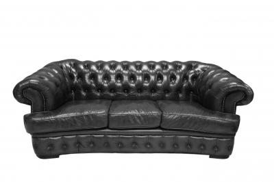 Czarna sofa na tle białej ściany - FreeDigitalPhotos.net by  Nutdanai Apikhomboonwaroot