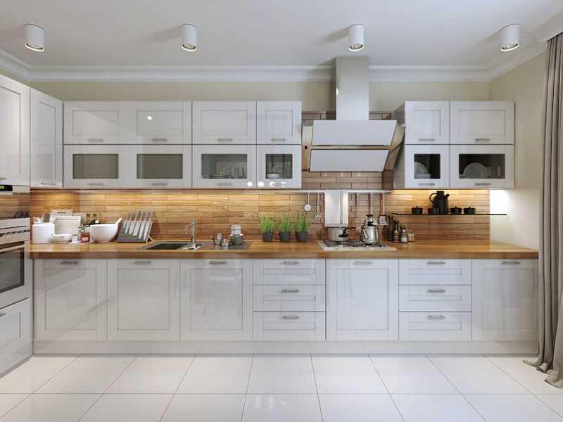 Przykład atrakcyjnie zaaranżowanej kuchni w kolorze białym
