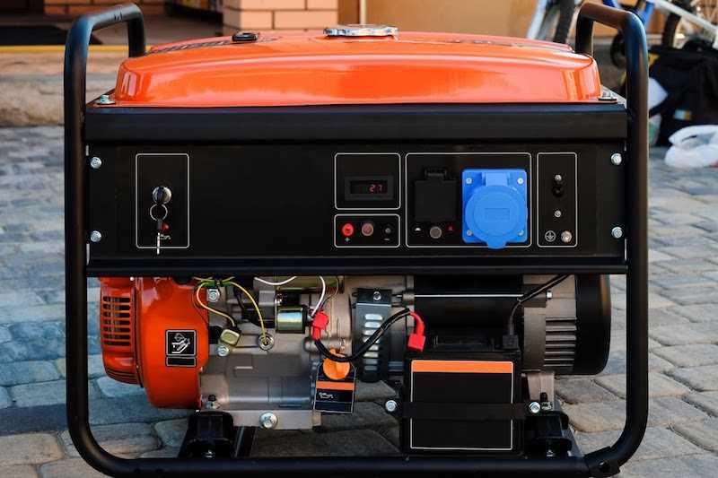 Agregat prądotwórczy stojący na kostce brukowej, a także jak wybrać agregat prądotwórczy, a także czy warto go kupić