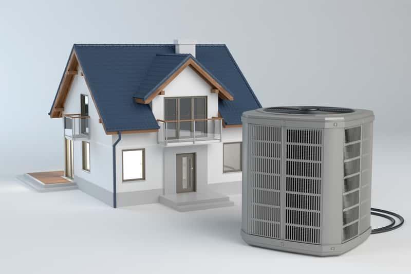 Pompa ciepła powietrze-woda przed makietą domu, a także informacje o pompach ciepła, sposób działania oraz najlepsze modele i polecani producenci