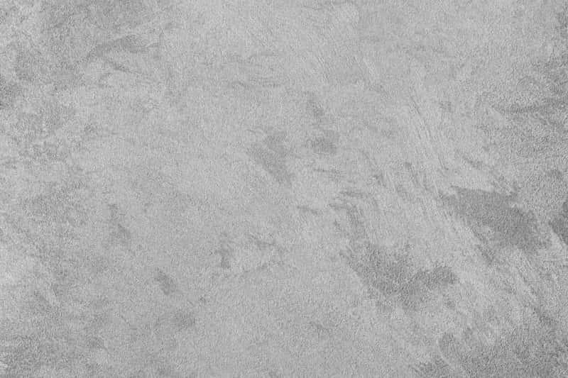 Szary beton na ścianie, a także karbonatyzacja betonu krok po kroku - co to jest, na czym polega i jak przeprowadzić karbonatyzację