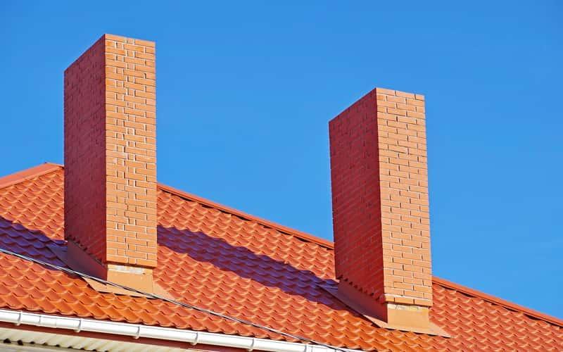 Dachówka holenderska na dużym budynku, a także opis fachówek, ceny, porady przy zakładaniu oraz opinie o producentach