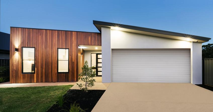 Dom jednorodzinny, a także oświetlenie elewacji domu i jego rodzaje