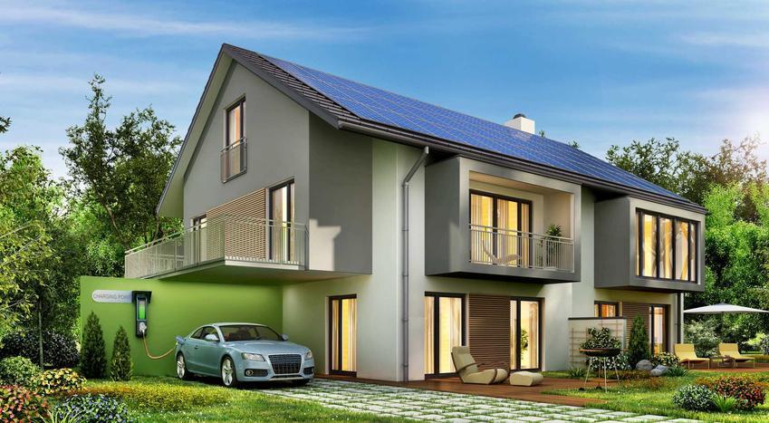 Szara elewacja na nowoczesnym domu umieszczonym w zielonym otoczeniu oraz TOP 10 innych pomysłów na szarą elewację